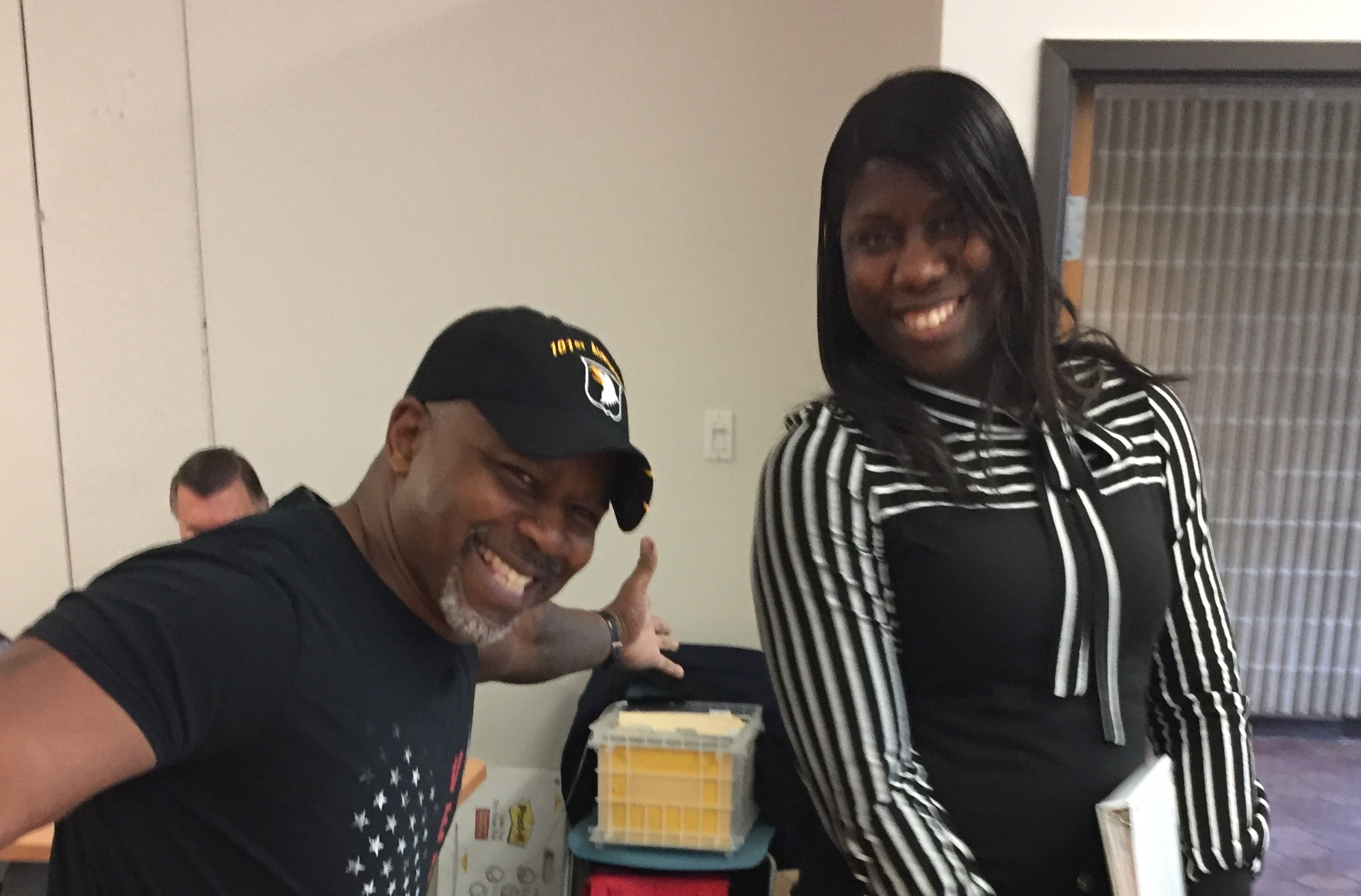 Two smiling people of color at veterans mediation training